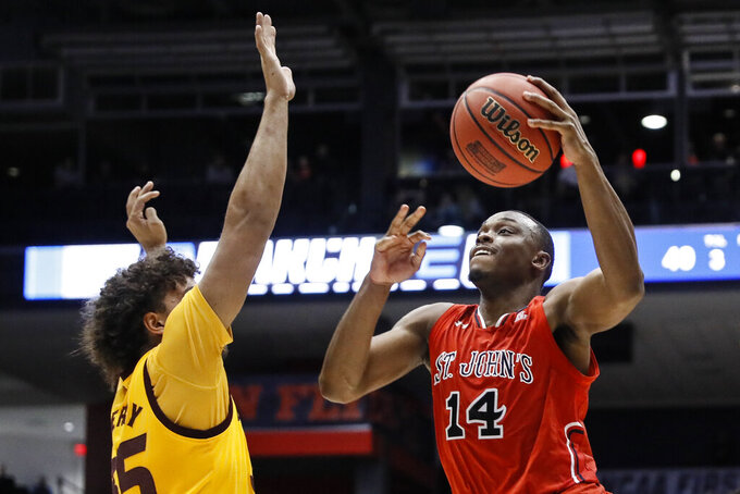 St. John's Mustapha Heron (14) shoots over Arizona State's Taeshon Cherry during the second half of a First Four game of the NCAA men's college basketball tournament Wednesday, March 20, 2019, in Dayton, Ohio. (AP Photo/John Minchillo)