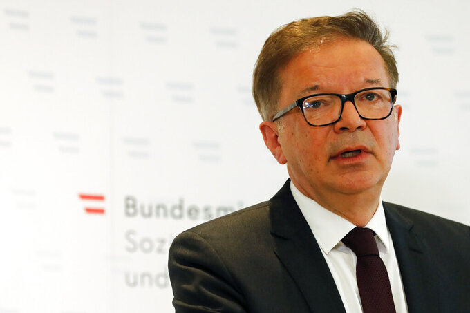 Austrian health minister Rudolf Anschober announces his resignation due to health problems and overworking in Vienna, Austria, Tuesday, April 13, 2021. Anschober said that he couldn't continue in the grueling job of helping lead the country's coronavirus response because of persistent personal health problems. (AP Photo/Lisa Leutner)