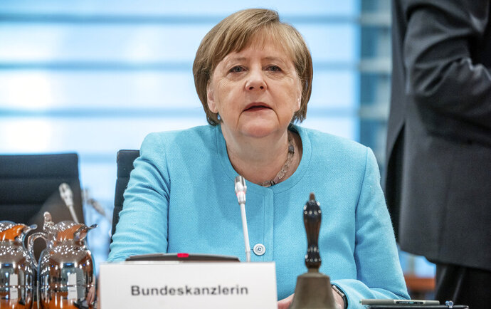 German Chancellor Angela Merkel attends the weekly cabinet meeting at the Chancellery in Berlin, Germany, Wednesday, June 3, 2020. (Michael Kappeler/DPA via AP, Pool)