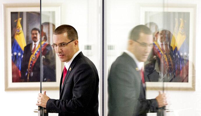 Venezuela's Foreign Minster Jorge Arreaza arrives for a press conference after visiting the International Criminal Court in The Hague, Netherlands, Thursday, Feb. 13, 2020. (AP Photo/Phil Nijhuis)