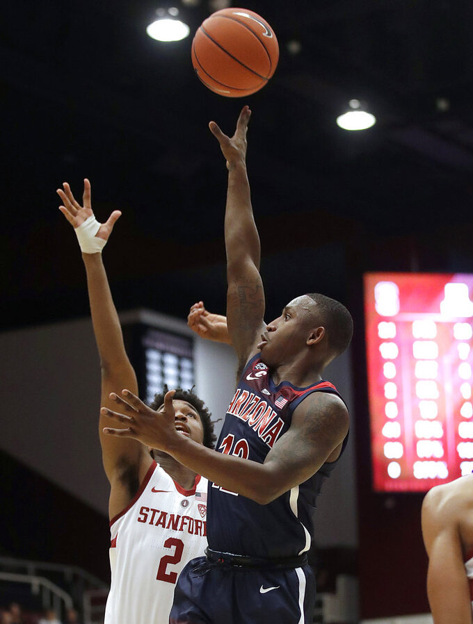 Arizona guard Justin Coleman (12) shoots over Stanford guard Bryce Wills (2) during the first half of an NCAA college basketball game in Stanford, Calif., Wednesday, Jan. 9, 2019. (AP Photo/Jeff Chiu)