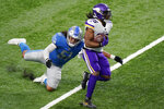 Minnesota Vikings running back Alexander Mattison (25) outruns Detroit Lions outside linebacker Jahlani Tavai (51) for a touchdown during the first half of an NFL football game, Sunday, Jan. 3, 2021, in Detroit. (AP Photo/Carlos Osorio)
