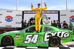 Kyle Busch celebrates in Victory Lane after wining the NASCAR Xfinity Series auto race Saturday, July 10, 2021, in Hampton, Ga. (AP Photo/John Amis)
