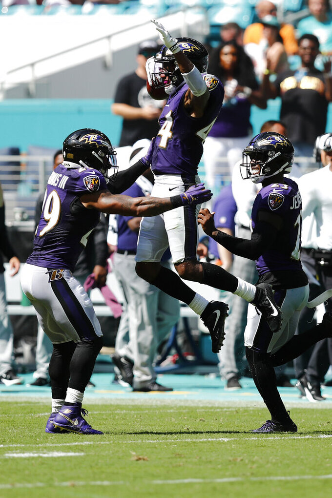 Baltimore Ravens cornerback Marlon Humphrey (44), center, celebrates after intercepting a pass, during the second half at an NFL football game, Sunday, Sept. 8, 2019, in Miami Gardens, Fla. (AP Photo/Brynn Anderson)