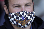 E.J. Falk, of Detroit, wears a face covering at the Indianapolis 500 auto race at Indianapolis Motor Speedway in Indianapolis, Sunday, May 30, 2021. (AP Photo/Paul Sancya)