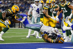 Dallas Cowboys' Ezekiel Elliott (21) runs into the end zone for a touchdown against Green Bay Packers' Dean Lowry, bottom, during the second half of an NFL football game in Arlington, Texas, Sunday, Oct. 6, 2019. (AP Photo/Ron Jenkins)