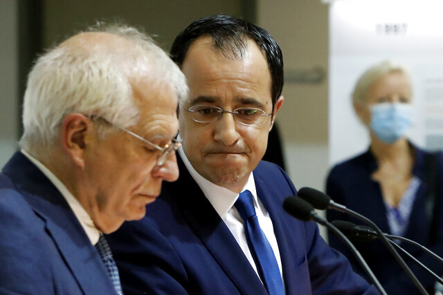 The European Union's Foreign Policy Chief Josep Borrell, left, and Cyprus' Foreign Minister Nikos Christodoulides speak during a joint news conference at the Cypriot foreign ministry on Thursday, June 25, 2020. Borrell is in Cyprus to discuss developments in the EU's southeastern-most corner. (AP Photo/Petros Karadjias)