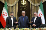 From left to right, spokesman for Iran's atomic agency Behrouz Kamalvandi, Iran's government spokesman Ali Rabiei and Iranian Deputy Foreign Minister Abbas Araghchi, attend a press briefing in Tehran, Iran, Sunday, July 7, 2019. The deputy foreign minister says that his nation considers the 2015 nuclear deal with world powers to be a