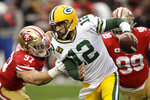 Green Bay Packers quarterback Aaron Rodgers (12) is sacked by San Francisco 49ers defensive end Nick Bosa (97) during the first half of the NFL NFC Championship football game Sunday, Jan. 19, 2020, in Santa Clara, Calif. (AP Photo/Ben Margot)