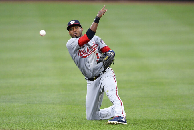 Washington Nationals second baseman Alcides Escobar throws to first to put out Baltimore Orioles' Ramon Urias during the fourth inning of a baseball game, Saturday, July 24, 2021, in Baltimore. (AP Photo/Nick Wass)