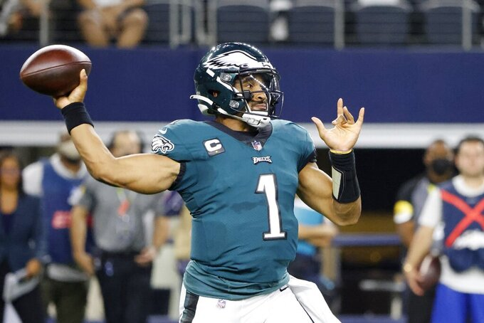 Philadelphia Eagles quarterback Jalen Hurts throws a pass in the first half of an NFL football game against the Dallas Cowboys14 in Arlington, Texas, Monday, Sept. 27, 2021. (AP Photo/Michael Ainsworth)