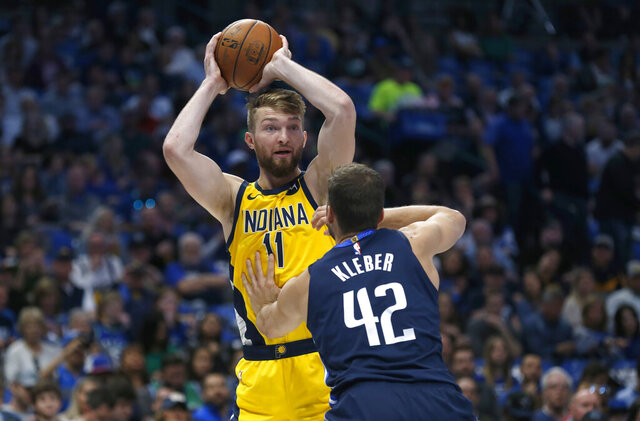 Indiana Pacers forward Domantas Sabonis (11) looks to pass over Dallas Mavericks forward Maxi Kleber (42) during the first half of an NBA basketball game, Sunday, March 8, 2020, in Dallas. (AP Photo/Ron Jenkins)
