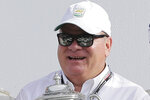 FILE - In this Jan. 28, 2018, file photo, team owner Chip Ganassi holds a trophy after his drivers took the top two spots in the GT LeMans class at the IMSA 24-hour auto race at Daytona International Speedway in Daytona Beach, Fla. Former NASCAR champion Matt Kenseth will once again come out of retirement to compete for Chip Ganassi Racing as the replacement for fired driver Kyle Larson. The team instead announced Monday, April 27, 2020, it will go with two-time Daytona 500 winner Kenseth for the remainder of the season.  (AP Photo/Terry Renna, File)