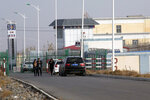 FILE.- In this Dec. 3, 2018, file photo, a police station is seen by the front gate of the Artux City Vocational Skills Education Training Service Center in Artux in western China's Xinjiang region. Confidential documents, leaked to a consortium of news organizations, lay out the Chinese government's deliberate strategy to lock up ethnic minorities to rewire their thoughts and the language they speak. One of the documents says that internment camps – such as the one in Artux – are to install police stations at gates, as well as other security measures to