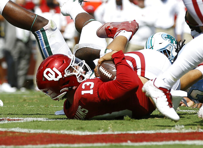 Oklahoma quarterback Caleb Williams (13) falls in the endzone for a touchdown against Tulane during a NCAA college football game Saturday, Sept. 4, 2021, in Norman, Okla. (AP Photo/Alonzo Adams)