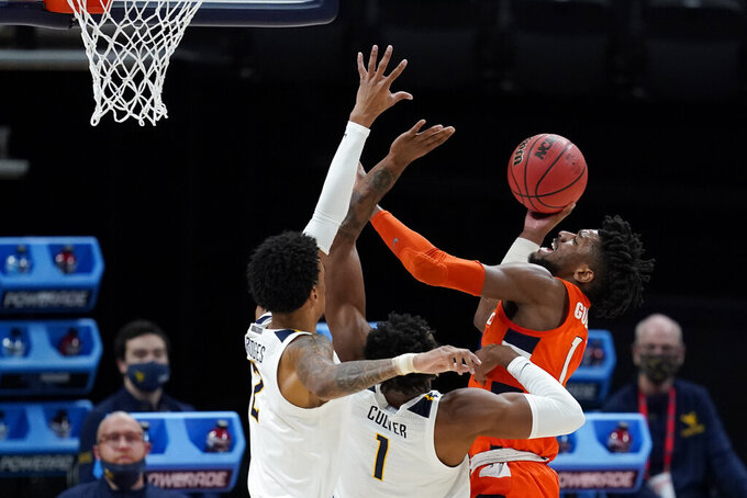Syracuse's Quincy Guerrier (1) shoots over West Virginia's Derek Culver (1) and Jalen Bridges (2) during the first half of a second-round game in the NCAA men's college basketball tournament at Bankers Life Fieldhouse, Sunday, March 21, 2021, in Indianapolis. (AP Photo/Darron Cummings)