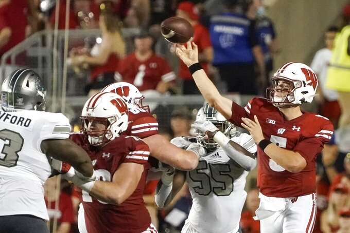 Wisconsin's Graham Mertz thorws during the first half of an NCAA college football game against Eastern Michigan Saturday, Sept. 11, 2021, in Madison, Wis. (AP Photo/Morry Gash)