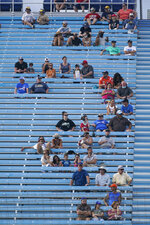 Fans watch a NASCAR Cup Series auto race, Sunday, Feb. 28, 2021, in Homestead, Fla. (AP Photo/Wilfredo Lee)