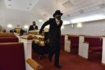 The casket of George Floyd arrives inside the church for a memorial service Saturday, June 6, 2020, in Raeford, N.C. Floyd died after being restrained by Minneapolis police officers on May 25. (Ed Clemente/The Fayetteville Observer via AP, Pool)