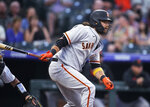 San Francisco Giants' Brandon Crawford watches his RBI single off Colorado Rockies starting pitcher Chi Chi Gonzalez in the first inning of a baseball game Tuesday, Sept. 7, 2021, in Denver. (AP Photo/David Zalubowski)