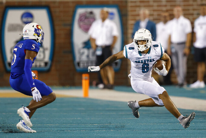 Coastal Carolina wide receiver Jaivon Heiligh, right, runs after a catch as Kansas safety O.J. Burroughs defends during the second half of an NCAA college football game in Conway, S.C., Friday, Sept. 10, 2021. Coastal Carolina won 49-22. (AP Photo/Nell Redmond)