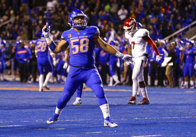 Boise State middle linebacker Tyson Maeva (58) celebrates after Fresno State turned the ball over on down late in the fourth quarter of an NCAA college football game, Friday, Nov. 9, 2018, in Boise, Idaho. Boise State won 24-17 over Fresno State. (AP Photo/Steve Conner)