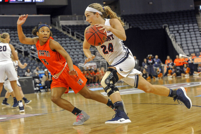 UT Martin's Brittni Moore (15) defends as Belmont's Jenny Roy (24) dribbles to the basket during the second half of an NCAA college basketball game in the championship of the Ohio Valley Conference basketball tournament, Saturday, March 9, 2019, in Evansville, Ind. (AP Photo/Daniel R. Patmore)