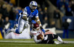 New Mexico State quarterback Josh Adkins (14) slides as BYU linebacker Sione Takitaki (16) jumps to down him during an NCAA college football game Saturday, Nov. 17, 2018, in Provo, Utah. (Isaac Hale/Daily Herald via AP)