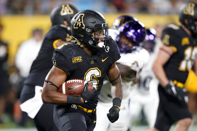 Appalachian State running back Camerun Peoples carries against East Carolina during the second half of an NCAA college football game Thursday, Sept. 2, 2021, in Charlotte, N.C. (AP Photo/Chris Carlson)
