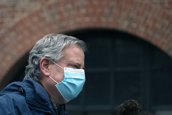 """FILE - In this April 24, 2020, file photo, New York City Mayor Bill de Blasio wears a mask while honoring healthcare workers at Brooklyn's Kings County Hospital Center in New York. The New York City Marathon scheduled for Nov. 1, 2020, has been cancelled because of the coronavirus pandemic.  """"While the marathon is an iconic and beloved event in our city, I applaud New York Road Runners for putting the health and safety of both spectators and runners first,"""" Mayor Bill de Blasio said in a statement.  (AP Photo/Mark Lennihan, FIle)"""