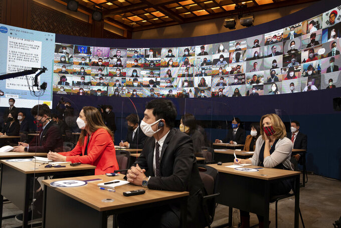 Journalists attend at an on-line New Year press conference by South Korean President Moon Jae-in at the Presidential Blue House in Seoul, South Korea Monday, Jan. 18, 2021. (Jeon Heon-kyun/Pool Photo via AP)