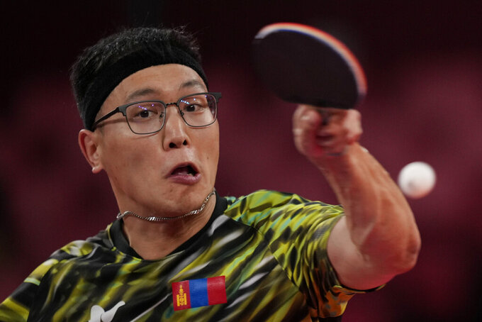 Mongolia's Enkhbat Lkhagvasuren competes during men's table tennis singles preliminary round match against Nikhil Kumar, of United States at the 2020 Summer Olympics, Saturday, July 24, 2021, in Tokyo. (AP Photo/Kin Cheung)
