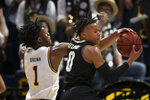 Colorado guard Shane Gatling (0) grabs a defensive rebound in front of California guard Joel Brown (1) during the first half of an NCAA college basketball game Thursday, Feb. 27, 2020, in Berkeley, Calif. (AP Photo/D. Ross Cameron)