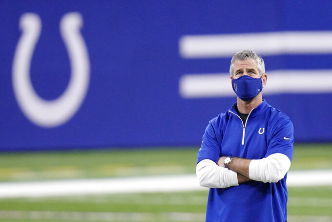 Indianapolis Colts head coach Frank Reich watches as the Colts warm up before an NFL football game against the Jacksonville Jaguars, Sunday, Jan. 3, 2021, in Indianapolis. (AP Photo/AJ Mast)