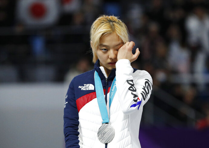Silver medalist Kim Bo-reum of South Korea cries on the podium after the women's mass start speedskating race at the Gangneung Oval at the 2018 Winter Olympics in Gangneung, South Korea, Saturday, Feb. 24, 2018. (AP Photo/John Locher)