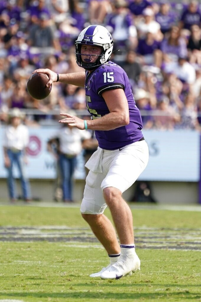 TCU quarterback Max Duggan prepares to throw a pass in the second half of an NCAA college football game against California in Fort Worth, Texas, Saturday, Sept. 11, 2021. (AP Photo/Tony Gutierrez)