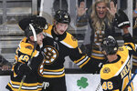 Boston Bruins left wing Danton Heinen (43) is congratulated by teammates after his goal against Ottawa Senators goaltender Craig Anderson during the third period of an NHL hockey game in Boston, Saturday, Nov. 2, 2019. (AP Photo/Charles Krupa)