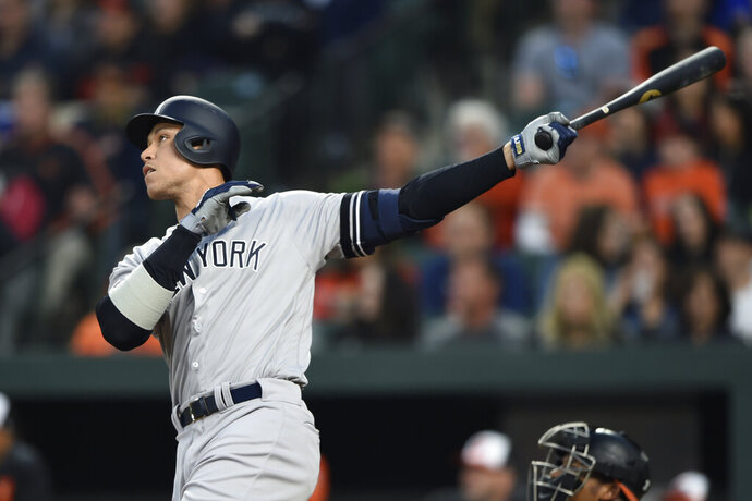 New York Yankees' Aaron Judge follows through on a solo home run against the Baltimore Orioles during the first inning of a baseball game Saturday, April 6, 2019, in Baltimore. (AP Photo/Gail Burton)