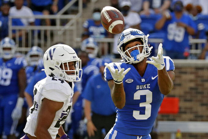 Duke wide receiver Darrell Harding Jr. (3) hauls in a pass for a big gain against Northwestern defensive back Rod Heard II (24) during the first half of an NCAA college football game in Durham, N.C., Saturday, Sept. 18, 2021. Duke scored shortly after this play. (AP Photo/Chris Seward)