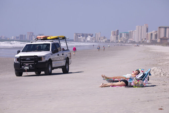 North Myrtle Beach opened public beach access after Governor Henry McMaster removed his order allowing local municipalities to make their own decisions as of noon on Tuesday, April 20, 2020 in North Myrtle Beach, S.C.  (Jason Lee/The Sun News via AP)
