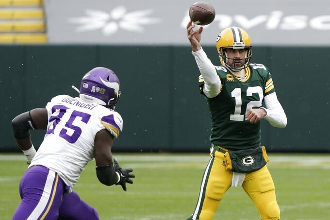 Green Bay Packers' Aaron Rodgers throws during the first half of an NFL football game against the Minnesota Vikings Sunday, Nov. 1, 2020, in Green Bay, Wis. (AP Photo/Morry Gash)