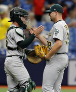 Oakland Athletics relief pitcher Blake Treinen, right, and catcher Beau Taylor celebrate after the team defeated the Tampa Bay Rays during a baseball game Wednesday, June 12, 2019, in St. Petersburg, Fla. Oakland defeated Tampa Bay 6-2.(AP Photo/Chris O'Meara)