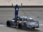 Kevin Harvick stands on his car as he celebrates his win in the NASCAR Cup Series auto race at Kansas Speedway on Saturday, May 12, 2018, in Kansas City, Kan. (AP Photo/Ed Zurga)