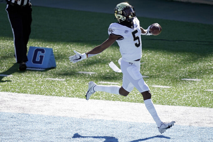 Wake Forest wide receiver Jaquarii Roberson (5) scores a touchdown against North Carolina during the first half of an NCAA college football game in Chapel Hill, N.C., Saturday, Nov. 14, 2020. (AP Photo/Gerry Broome)