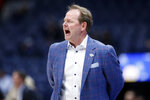 Mississippi head coach Kermit Davis yells to his players in the first half of an NCAA college basketball game against Georgia in the Southeastern Conference Tournament Wednesday, March 11, 2020, in Nashville, Tenn. (AP Photo/Mark Humphrey)