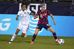 United States' Megan Rapinoe controls the ball as Mexico's Bianca Sierra defends during the first half of an international friendly soccer match, Thursday, July 1, 2021, in East Hartford, Conn. (AP Photo/Jessica Hill)