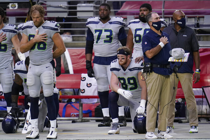 Seattle Seahawks tight end Will Dissly (89) kneels during the national anthem prior to an NFL football game against the Arizona Cardinals, Sunday, Oct. 25, 2020, in Glendale, Ariz. (AP Photo/Ross D. Franklin)