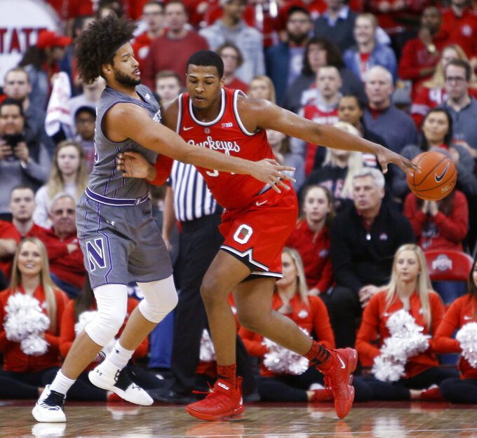 Northwestern's Barret Benson, left, knocks the ball away from Ohio State's Kaleb Wesson during the first half of an NCAA college basketball game Wednesday, Feb. 20, 2019, in Columbus, Ohio. (AP Photo/Jay LaPrete)
