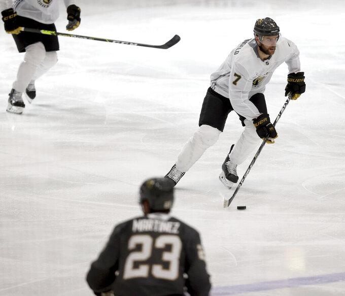 Vegas Golden Knights defenseman Alex Pietrangelo controls the puck during a scrimmage during NHL hockey training camp in Las Vegas, Monday, Jan. 4, 2021. (K.M. Cannon/Las Vegas Review-Journal via AP)