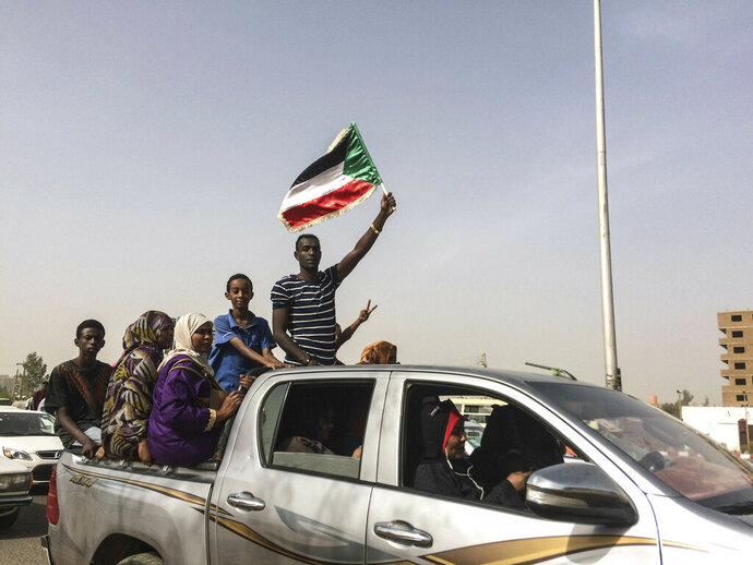 Protesters celebrate in Khartoum, Sudan, Thursday, April 11, 2019. Tens of thousands of Sudanese were making their way to the center of the country's capital on Thursday, cheering and clapping in celebration as two senior officials said the military had forced longtime autocratic President Omar al-Bashir to step down after 30 years in power. (AP Photo)